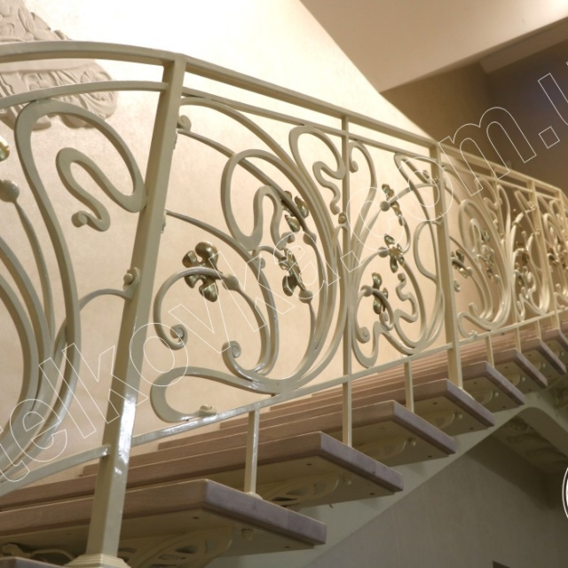 Wrought iron staircase with golden leaves