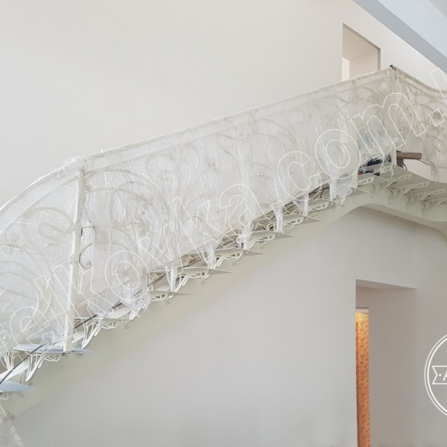 Forged staircase on a beam
