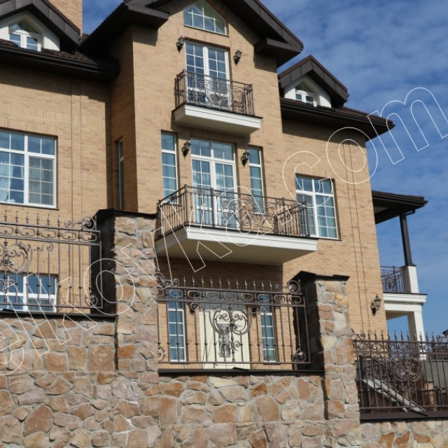Wrought iron balconies and fence