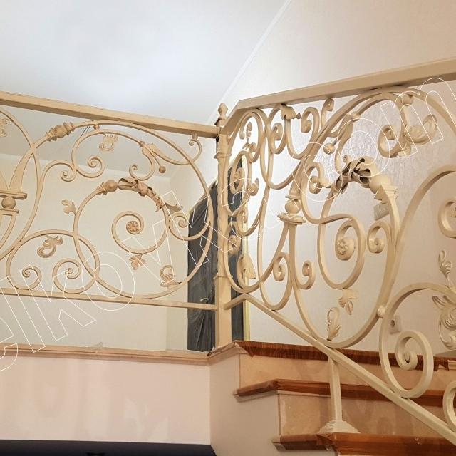 White wrought iron railing