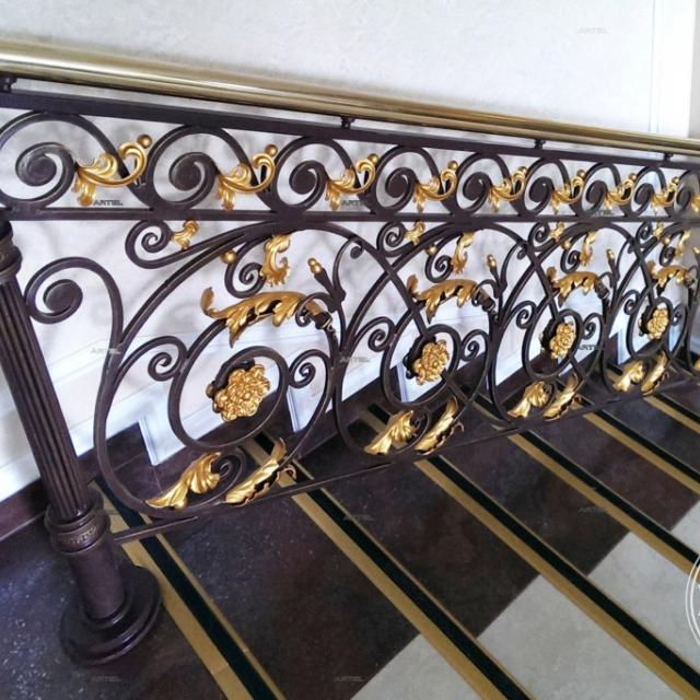 Forged railing with brass handrail