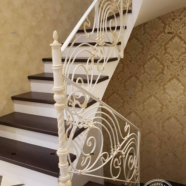 White forged staircase