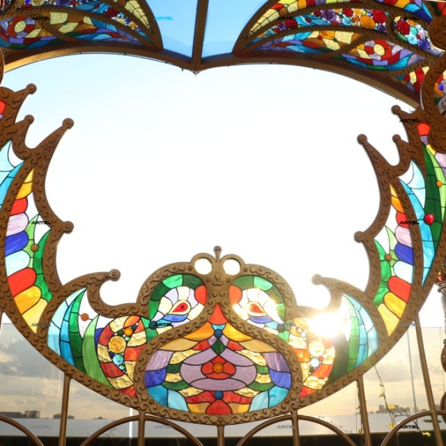 Wrought iron swing with stained glass