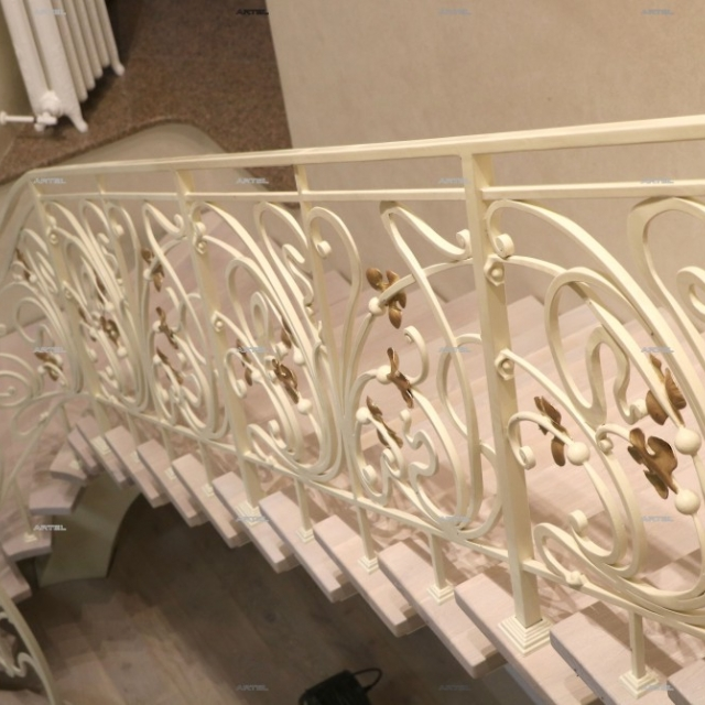 White staircase with golden leaves