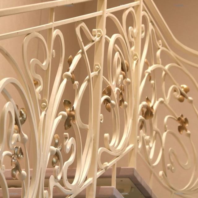 White wrought iron staircase