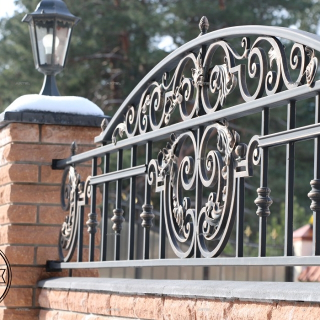 Forged fence top